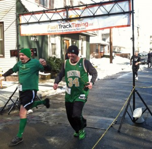 Racers cross the finish line during last year's St. Patrick's Day Road Race in Naugatuck. The race has been renamed the Ion Bank St. Patrick's Day Road Race and Festival this year and will be held March 15. –FILE PHOTO