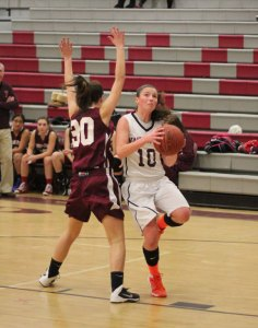 Naugatuck's Angelina Piccirillo(10) led the No. 27 Greyhounds with eight points Tuesday night against the No. 6-seeded Wilton in the first round of the Class L state tournament. Wilton defeated Naugatuck, 61-25. –FILE PHOTO
