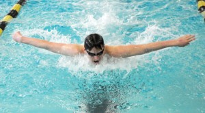 Woodland's Aiden Music does the butterfly stroke during the 200 IM Jan. 31 in a meet versus Holy Cross in Beacon Falls. Music won the event with a time of 2:14:12. Holy Cross won the meet, 90-79. Despite a 2-5 start to the year, the Hawks continue to swim to individual best times. –LUKE MARSHALL