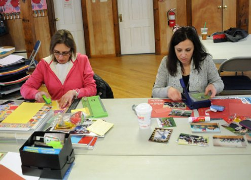 Beacon Falls residents Rosa Villano, left, and Lisa Accutura work on their scrapbooks during the 9th Annual Cabin Fever Crop Fest Feb. 15 at the Beacon Falls Congregational Church. The 12-hour event raised money for improvements to the church and included food, raffles and vendors throughout the day. –LUKE MARSHALL