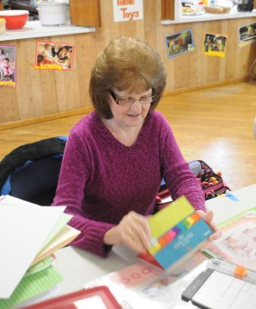 Beacon Falls resident Mary Winnie scrapbooks during the 9th Annual Cabin Fever Crop Fest Saturday at the Beacon Falls Congregational Church. The 12-hour event raised money for improvements to the church and included food, raffles and vendors throughout the day. –LUKE MARSHALL