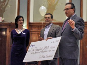 President and CEO of Ion Bank Charles Boulier III, right, talks as he holds a novelty check for $100,000 Feb. 7 during an event to kickoff the Treasure the Y capital campaign in the Neary Ballroom Room on Church Street as Naugatuck YMCA CEO Susan Talbot, left, and Campaign Chairman Paul Fitzpatrick look on. The campaign is seeking to raise $850,000 for infrastructure improvements to the YMCA. –ELIO GUGLIOTTI