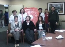 Members of Glendale Center's cardiac management program's transitional care unit team pose for a picture in front of the Glendale's heart board. The center collected over $200 for American Heart Association and American Stroke Association in February with contributions from residents, patients, staff and families. The pinnacle of the event was a 'Wear Red Day' on Feb. 7. -CONTRIBUTED
