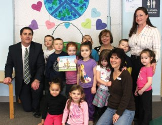 Naugatuck Mayor Robert Mezzo, left, visited a preschool class at the Naugatuck YMCA Feb. 28 at read 'Have You Filled A Bucket Today' by Carol McCloud to the children. -CONTRIBUTED