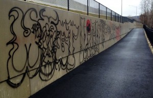 Someone spray-painted graffiti on the walls along a new greenway walking path in the Union City section of Naugatuck last week. –RA ARCHIVE