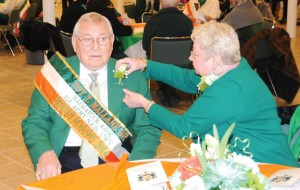 Barbara Mallane pins a corsage on her husband Roy Mallane Monday in the church hall of St. Francis Church in Naugatuck. Roy Mallane was honored as Naugatuck's Irish Mayor for the Day. –LUKE MARSHALL