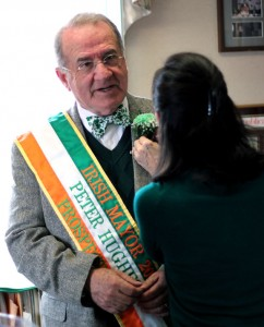 Catherine Hughes pins a corsage on her husband Peter Hughes Monday morning in the mayor's office in Prospect Town Hall. Peter Hughes was honored as Prospect's Irish Mayor for the Day. –ELIO GUGLIOTTI