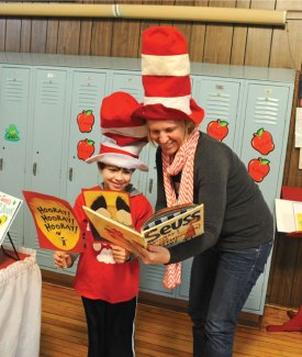 Guest reader Kris Generali and her son Reeve Generali, a first-grader at Salem Elementary School, look over 'Hooray for Diffendoofer Day!,' by Dr. Seuss March 7. Generali, along with other guest readers, were at the school to celebrate Read Across America, which honors Dr. Seuss' birthday and encourages children to read. –LUKE MARSHALL