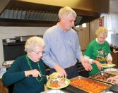 From left, Kathryn Green, Naugatuck Tax Collector Jim Goggin and Carole Mancini serve corned beef, cabbage, carrots and potatoes during the Naugatuck Senior Center's St. Patrick's Day luncheon March 6. In addition to food, seniors were treated to Irish songs sung by the Brothers of the Novitiate Choir from the Legion of Christ College in Cheshire. Senior Center Director Harvey Frydman said that the event, which started nine years ago, drew over 125 people. –LUKE MARSHALL