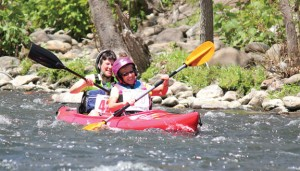 Brenda Murphy of Sandy Hook, front, and Jill Waldron of Naugatuck kayak down the Naugatuck River in Beacon Falls during the sixth annual Naugatuck Valley River Race last year. This year's race and River Fest will be held May 3. –FILE PHOTO