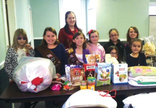 Prospect Girl Scout Troop 64177 collected and donated blankets, food and toys to the Connecticut Humane Society. Linda, a volunteer from the Connecticut Humane Society came to pick up all the donations and talked to the girls about responsible pet ownership. -CONTRIBUTED