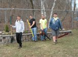 Boy Scouts from Troop 138 in Naugatuck, from left, Charles Fogie, Sean Main, Nick Ryan and Jared Main assisted Naugatuck Beautification Committee Chair Gigi Ramos in planting flowers and cleaning up the Easter Village on Rubber Avenue April 5 as a project for Ryan to advance in rank toward Star Scout. -CONTRIBUTED