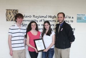 From left, Woodland Regional Student Council Vice President Jeff Lauck, council Speaker Mary Vlamis, council Chair of Governmental Affairs Lindsey Rodorigo and council advisor Chris Tomlin display the 2014 National Gold Council of Excellence award the student council received from the National Association of Student Councils at the school in Beacon Falls. The recognition is awarded to student councils that demonstrate the highest levels of leadership and embrace exceptional activities, according to the NASC website. –ELIO GUGLIOTTI