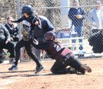 Naugatuck catcher Shannon Searles (25) tags out Woodland's Natalie Veneri (16) during a play at home plate April 17 at Breen Field in Naugatuck. The Hawks won the game, 6-5, in extra innings. –LUKE MARSHALL
