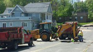 A sink hole on Hillside Avenue near the intersection of Meadow Street in Naugatuck was discovered by a resident Saturday morning. –RA ARCHIVE