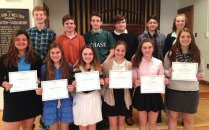 Chase Collegiate eighth-grader Catherine Walsh, of Prospect, (third from the left in the front row) was among the students at the Waterbury school to be named a Declamation winner. Each year, students in grades seven and eight present two formal speeches, known as Declamations to their entire class, parents and guests. –CONTRIBUTED