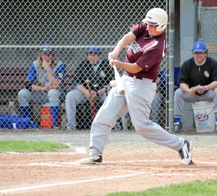 Naugatuck's Spencer Dreher rips a single May 7 versus Seymour in Naugatuck. Seymour won the game 3-1. The Greyhounds followed the loss with two wins. –ELIO GUGLIOTTI