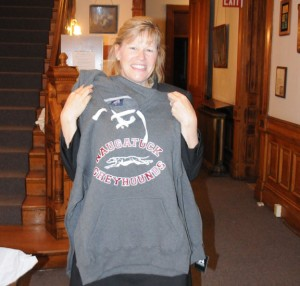 Sharon Locke holds up a Naugatuck Greyhounds hoodie after being hired as the next superintendent of schools Wednesday night. Locke will start on July 1. –LUKE MARSHALL