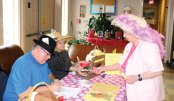 Elaine 'Buzzy' Bloderick, right, purchases a raffle ticket for a 'horse race' from Naugatuck Mayoral Aid Ed Carter and Registrar of Voters Louise Sheedy during the Naugatuck Senior Center's third annual Kentucky Derby Day May 2. Aside from the 'horse race' the day featured a Kentucky Derby Dinner, informational vendors, and plenty of decorative hats. –LUKE MARSHALL