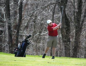 Naugatuck's Brendan Waldron shoots for the green during a match against Woodland April 28 at Oxford Greens in Oxford. Woodland won the match, 198-205, but the Greyhounds rebounded with a 173-181 victory over Watertown April 29. –ELIO GUGLIOTTI