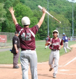 Naugatuck's Josh Aviles (3) is greeted at home plate by Spencer Dreher (42) after scoring the first run for the Greyhounds Tuesday versus Ansonia in the quarterfinals of the NVL tournament at Rotary Field in Naugatuck. The Chargers knocked out Naugatuck, 3-2. –KEN MORSE