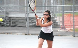 Naugatuck's No. 1 singles player Hannah Kim returns a shot May 2 during a match versus Holy Cross in Naugatuck. Naugatuck beat the Crusaders 4-3. –ELIO GUGLIOTTI