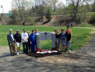 Former Naugatuck Mayor Joan Taf, pictured with her family, was honored by the Naugatuck Parks and Recreation Commission May 10 by dedicating a field at Linden Park in the Union City section in her honor. Taf was honored for the work she put into enhancing Linden Park. She was Naugatuck's first female mayor and served two terms from 1999 to 2003. The commission posthumously dedicated the Fawn Meadow Field to former Union City Little League President Paul Bendler Sr. May 3 and will honor the late Robert Paolino, a former mayor, May 17 by dedicating the meadow at Gunntown Passive Park and Nature Preserve to him. –CONTRIBUTED