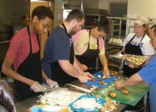 Students from the Naugatuck United Methodist Church High School Sunday School volunteer May 18 at the St. Vincent DePaul Soup Kitchen in Waterbury as part of the United Methodist Church's national Change the World campaign. The students, who were supervised by teacher Chris Herb, prepared, cooked and served a meal to clients at the soup kitchen. –CONTRIBUTED