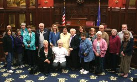 A group from the Prospect Senior Center met with state Rep. Lezlye Zupkus (R-89) during a tour of the Capitol May 22. Zupkus (in blue in center) talked about the legislative process as well as history of the House of Representative chamber with the group. From there, she took the visitors the House Republican caucus room where she briefed them on some of the issues from the 2014 legislative session. –CONTRIBUTED