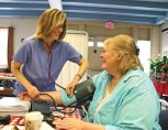 Rhonda Lord of the Naugatuck Visiting Nurses Association checks the blood pressure of Sharon Helmes during the Naugatuck Senior Health and Wellness Clinic June 19 at the Naugatuck Senior Center. The annual clinic provides a variety of screenings to seniors. Senior center Director Harvey Frydman said center was able to host the clinic because of a $20,000 grant from the state and the donation of time and services from the Western Connecticut Area Agency on Aging. –LUKE MARSHALL