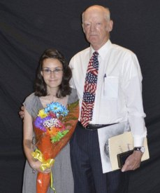 Woodland senior Paulette Burgio, left, is presented the R. Thomas Merriman Fine Arts Scholarship from Prospect Town Councilman Doug Merriman during the annual Senior Scholarship Night June 12. –CONTRIBUTED