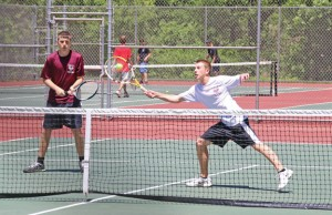 Naugatuck's Jake Morrissey hits a forehand while Jeff Hensley backs him up during the NVL tournament last week at Wolcott High School. The duo reached the semifinals before being knocked off. –LUKE MARSHALL
