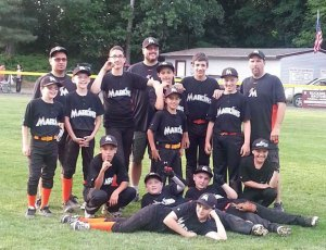The Union City Little League champion Marlins (standing from left) Josh Redding, coach George Cruz, Ryan Maguire, Ty Coney, coach John Jagello, Alvin Torres, Adam Ferrara, Derrick Jagello, coach Dennis Sigetti, (kneeling) George Cruz, Antonio Reyes, (laying down) Jeff schebell, Ryan (Kemo) Sutherland and Devin Conway. –CONTRIBUTED