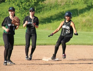 Woodland's Samantha White (14) reaches second base June 2 versus Northwest Catholic High School during the first round of the Class M tournament in Beacon Falls. Woodland won the game, 7-4, but fell in the second round June 3 to Suffield. –LUKE MARSHALL