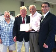 Former interim Naugatuck Superintendent of Schools James Connelly was presented with a certificate of appreciation June 23 for his service on the Naugatuck Economic Development Corporation Board of Directors. June 23 was Connelly's last meeting on the board, which holds a seat for the superintendent. Pictured, from left, NEDC Board Chair Jay Carlson Connelly, NEDC CEO Ron Pugliese and Mayor Robert Mezzo. –CONTRIBUTED