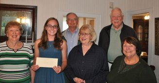 The Prospect Historical Society recently presented its 2014 Nellie and Ruth Cowdell Scholarship to Woodland Regional High School graduate Angeline Rosato. Rosato will attend American University in Washington D.C. this fall. While at Woodland, Rosato was on the Student Council, played varsity sports and was named to the National Honor Society and the Math Honor Society. The scholarship is awarded to a graduating senior from Prospect who is attending an institution of higher learning. It is awarded based on scholarship, financial need, service and a short essay about Prospect. 'My childhood has been the best possible,' Rosato wrote in her essay, 'and I can only credit that to living in Prospect.' For more information, visit www.prospecthistoricalsociety.org. Pictured (front row from left) Prospect Historical Society member Beth Whelan, Rosato, society members Nancy Via, Linda Weingart (back row from left) John Guevin and Tom Jokubaitis. -CONTRIBUTED