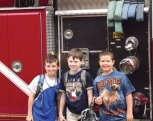 Andrew Hopkinson, right, of Laurel Ledge School in Beacon Falls celebrated his birthday June 11 with a ride to school in a fire truck from Beacon Hose Company No. 1. Hopkinson's mom won the prize in the Beacon Falls Lioness Club's silent auction at the recent Beacon Falls Duck Race. Hopkinson invited his friends, Caleb and Robert to join him. -CONTRIBUTED