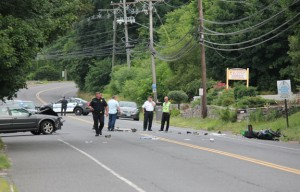 Police investigate an accident on New Haven Road near Laurel Avenue in Naugatuck Tuesday morning. –ELIO GUGLIOTTI