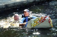 The Beacon Falls Parks and Recreation Commission hosted the Second Annual Cardboard Boat Regatta Saturday at Matthies Park. Ten cardboard crafts participated in the race with seven completing the course before sinking. Boy Scout Troop 104 of Beacon Falls took first and second place and Beacon Hose Company No. 1 took third place. Pictured, Selectman Dom Sorrentino, front, and Joe Rodorigo get off to a wet start. –CONTRIBUTED