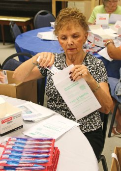 Margo Scott fills a dental kit July 16 at the Naugatuck Senior Center. The seniors filled over 2,000 kits with a toothbrush, a travel size tube of toothpaste and floss. Once they were filled the kits were distributed to expecting mothers by the Connecticut Dental Health Partnership. The seniors volunteer to fill these kits once a month. For more information, call the senior center at (203) 720-7069. –LUKE MARSHALL