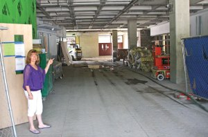 Naugatuck High School Principal Jan Saam shows off the work in July that is being done on the front entryway of the school as part of the $81 million renovation project. –LUKE MARSHALL