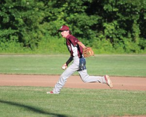 Post 17's Kyle Plasky barehands a chopper before throwing to first for the out during the first game of a doubleheader versus Bethel June 26 at Rotary Field in Naugatuck. Post 17 won the game 5-4. –ELIO GUGLIOTTI
