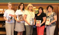 The Naugatuck Emblem Club recently donated a book to the Whittemore Library. The club has been donating a non-fiction book, written by a female author, in honor of each club president annually. Pictured from left, Library Director Jocelyn Miller, club members Deb Levasseur, Annette Balog, Laurel Rek and Kim Best. –CONTRIBUTED