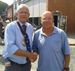 Naugatuck resident Peter Jurzynski, right, shakes hands with Town Mayor Councillor Alan North of Folkestone, England July 19 in Folkestone. Jurzynski, who had 14 successful solo swims across the English Channel through his retirement in 2010, still swims in the Channel when he visits the United Kingdom. –CONTRIBUTED