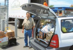 Dan Whitman of Naugatuck helped to collect 160 pounds of food donations in June during a Stock the Pantry Food Drive as part of the United Way's Day of Action. -CONTRIBUTED