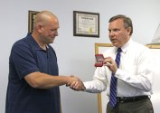 Beacon Falls First Selectman Christopher Bielik, right, presents former Beacon Hose Company No. 1 Fire Chief Michael Pratt with a silver money clip engraved with his initials in honor of his years of service to the town Aug. 11. Pratt served as chief from 2010 until 2014. Before presenting Pratt with the gift, Bielik told Pratt that the entire town appreciates the time and effort he put in as chief. 'It's a responsibility that nobody enters into lightly and everybody who takes it takes it seriously and helps to move this town forward and keep this town safe. We can't say enough to express our gratitude. Words fail us in trying to do that,' Bielik said. Pratt thanked the community for their support of him during his years as chief. –LUKE MARSHALL