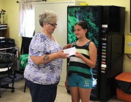 Lindsey Perssico, right, from the United Day School in Beacon Falls presents a check for $265 to Beacon Falls Senior Center Director Bernadette Dionne Aug. 1 at the senior center. The school raised the money at a lemonade stand in July. The money will go towards programming for seniors. 'It was a great surprise and we definitely appreciate it,' Dionne said. –ELIO GUGLIOTTI
