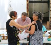 U.S. Rep. Rosa DeLauro (D-Conn) talks with Carmen Rodriguez of Waterbury during Naugatuck's farmers market Aug. 6 on the Green while Tom Giamattei of The Flower Farm in Prospect bags vegetables for Delauro. DeLauro visited Naugatuck as part of her 'Rosa on the Road' tour to meet with constituents. In addition to Naugatuck DeLauro visited Prospect. –LUKE MARSHALL