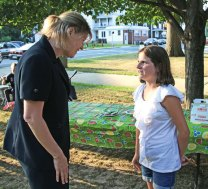 Naugatuck Superintendent of Schools Sharon Locke talks with fifth-grader Alyse Stauffer, 10, on the Green Aug. 5. Locke, who started as superintendent in July, held a meet and greet before the weekly concert to introduce herself and talk with members of the community. Locke will hold another meet and greet from 7 to 8 p.m. Aug. 20 on the Green before a family movie night. –LUKE MARSHALL