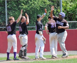 Mike Townsend, right, of the Connecticut Hackers is congratulated after hitting a solo homerun Sunday versus the Connecticut Flyers in the Connecticut National Adult Baseball Association quarterfinals. The Hackers won 7-6 to advance to the semifinals. –CONTRIBUTED